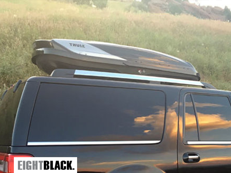Eight Black Cars use Thule Boxes to transport ski, poles, and boards to Colorado ski resorts